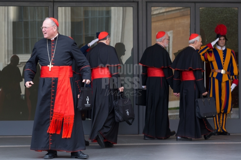 Vatican City: Cardinal Timothy Dolan and American Cardinals enter the IX Congregation of Cardinals, days before the election of Pope Francis. Photo: Gustavo Kralj/GaudiumpressImages