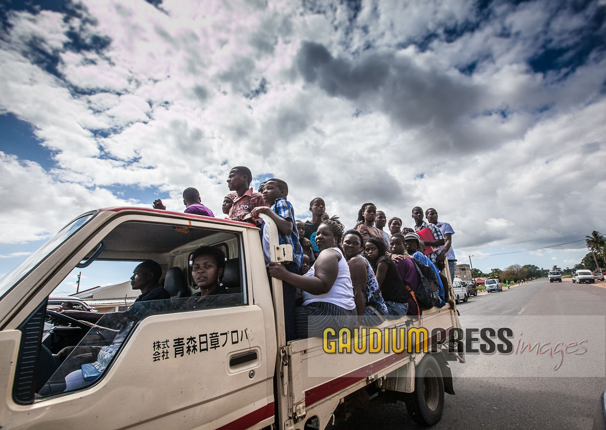 Africa: People commute to work by truck. ©Gustavo Kralj/Gaudiumpress Images